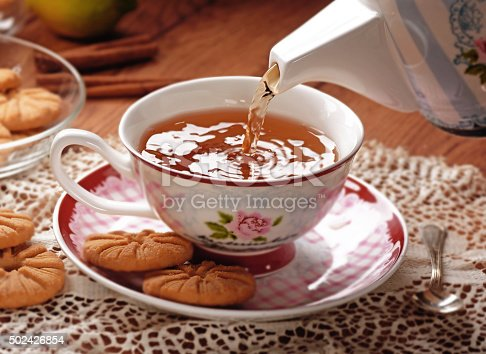 pour the hot tea in porcelain cup