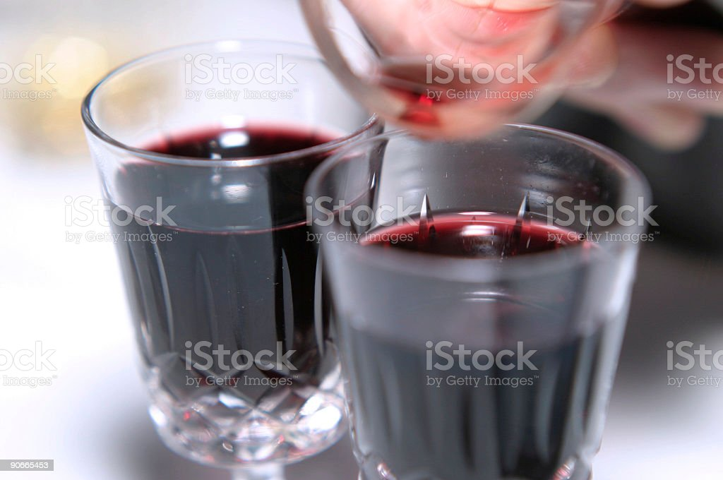 Pouring 2 glasses of port. royalty-free stock photo