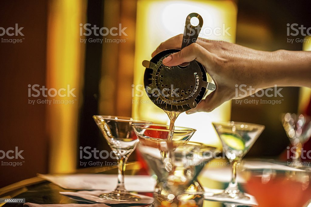 Pouring a cocktail from shaker on New year's eve stock photo