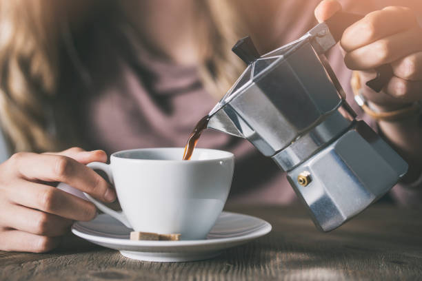 Pouring a cup of coffee Pouring a cup of coffee coffee pot stock pictures, royalty-free photos & images