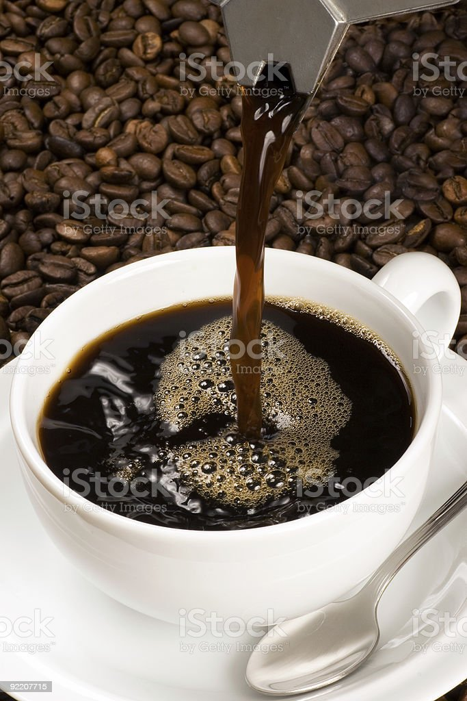 Pouring a cup of coffee royalty-free stock photo