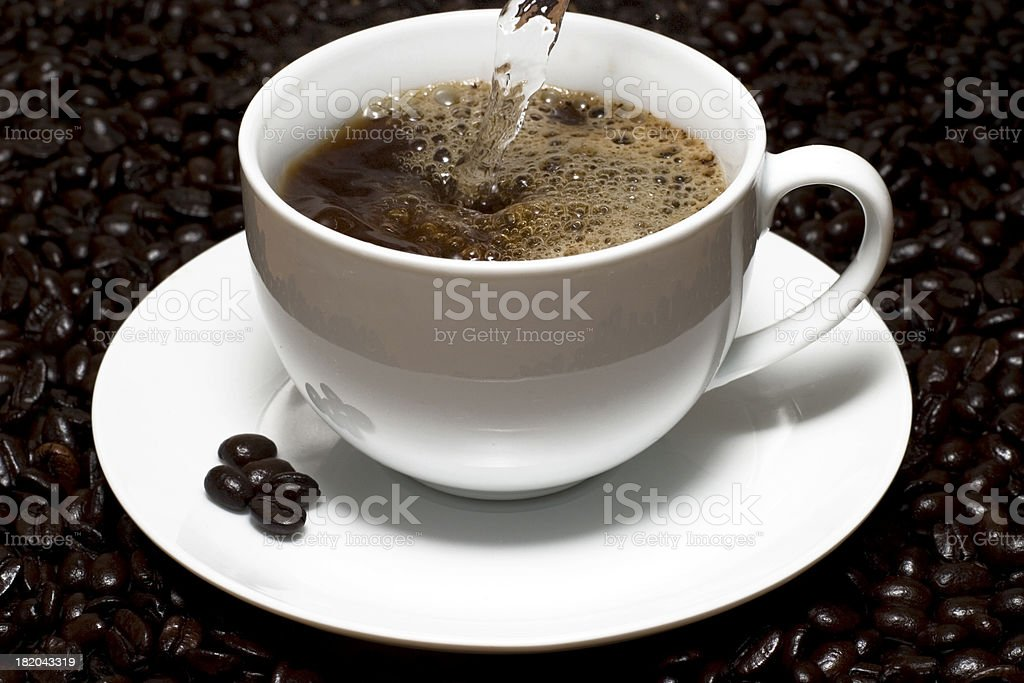 Pouring a cup royalty-free stock photo