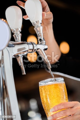 istock Pouring a Draft Blonde Beer from the Tap 506538103