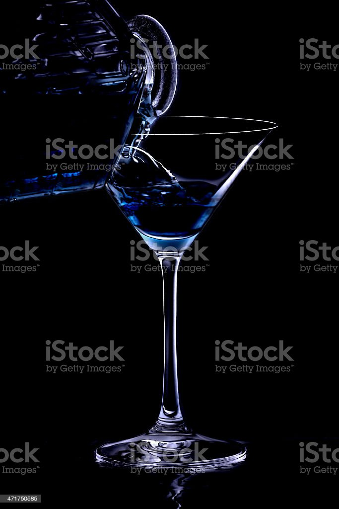 Pouring a drink in the night royalty-free stock photo