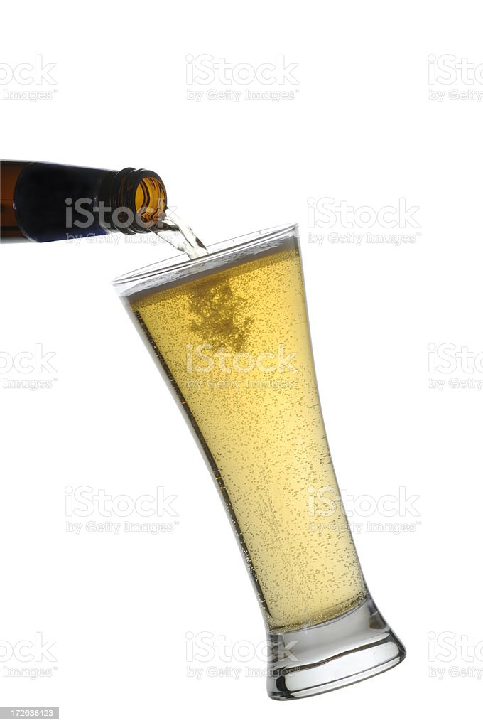 Pouring a full glass of beer w/clipping path royalty-free stock photo