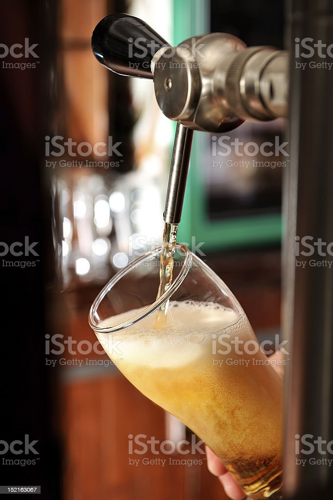 Pouring a glass of draft beer royalty-free stock photo