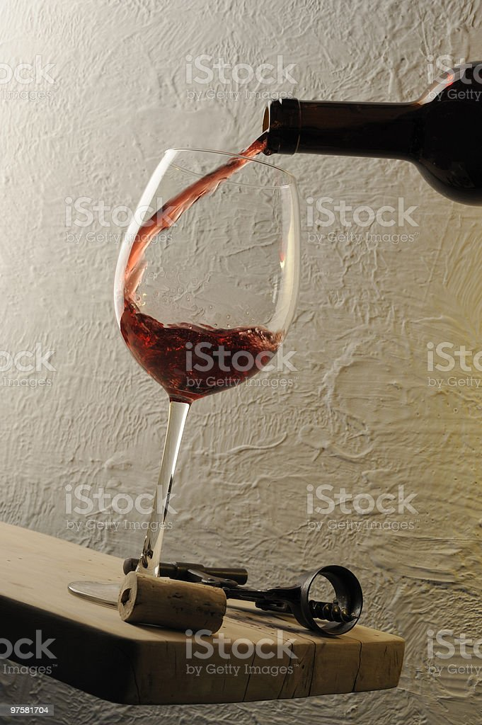 Pouring a glass of red wine royalty-free stock photo