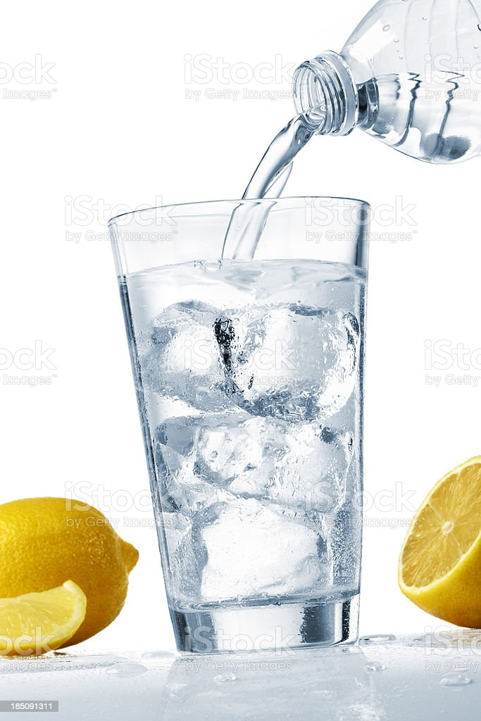 Pouring a glass of water stock photo