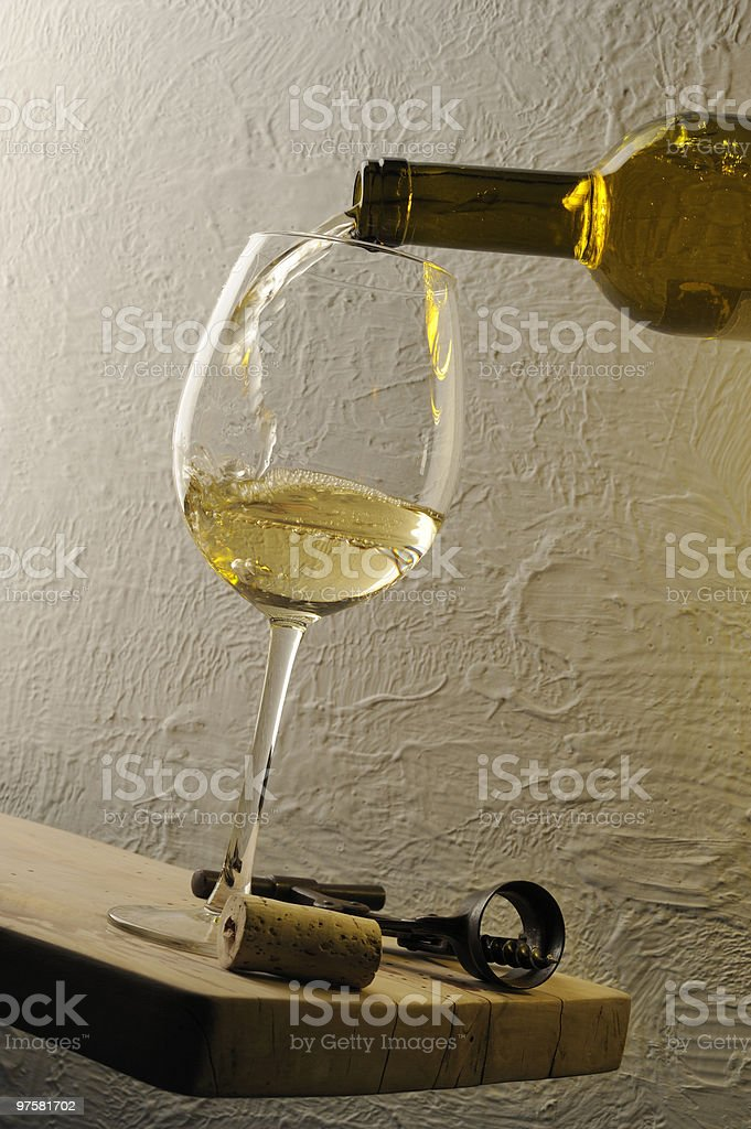 Pouring a glass of white wine royalty-free stock photo