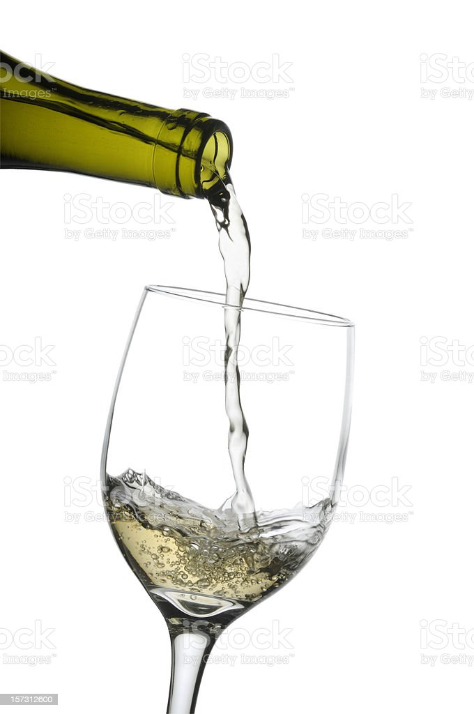Pouring a glass of white wine w/clipping path royalty-free stock photo