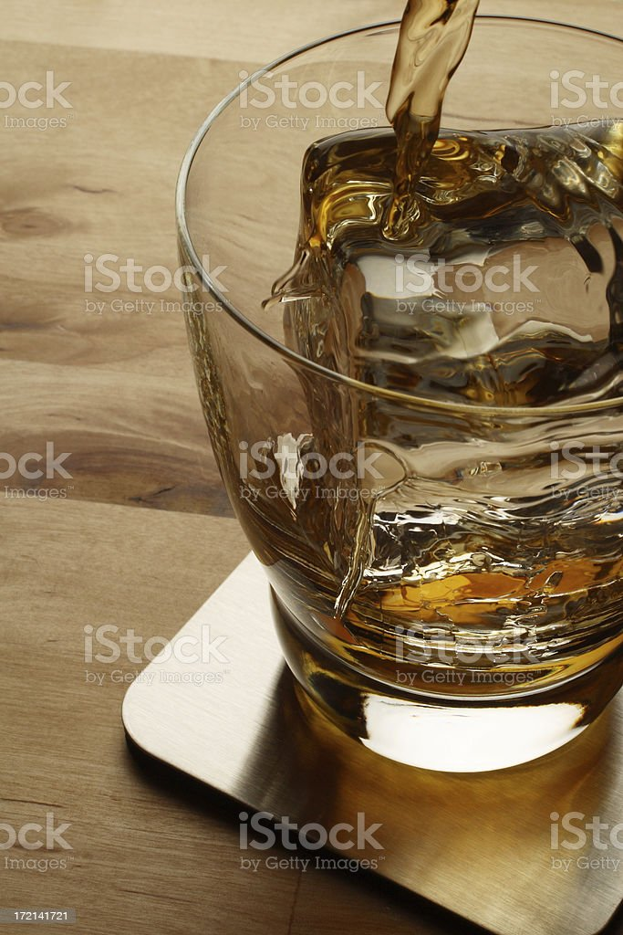 Pouring A Glass royalty-free stock photo