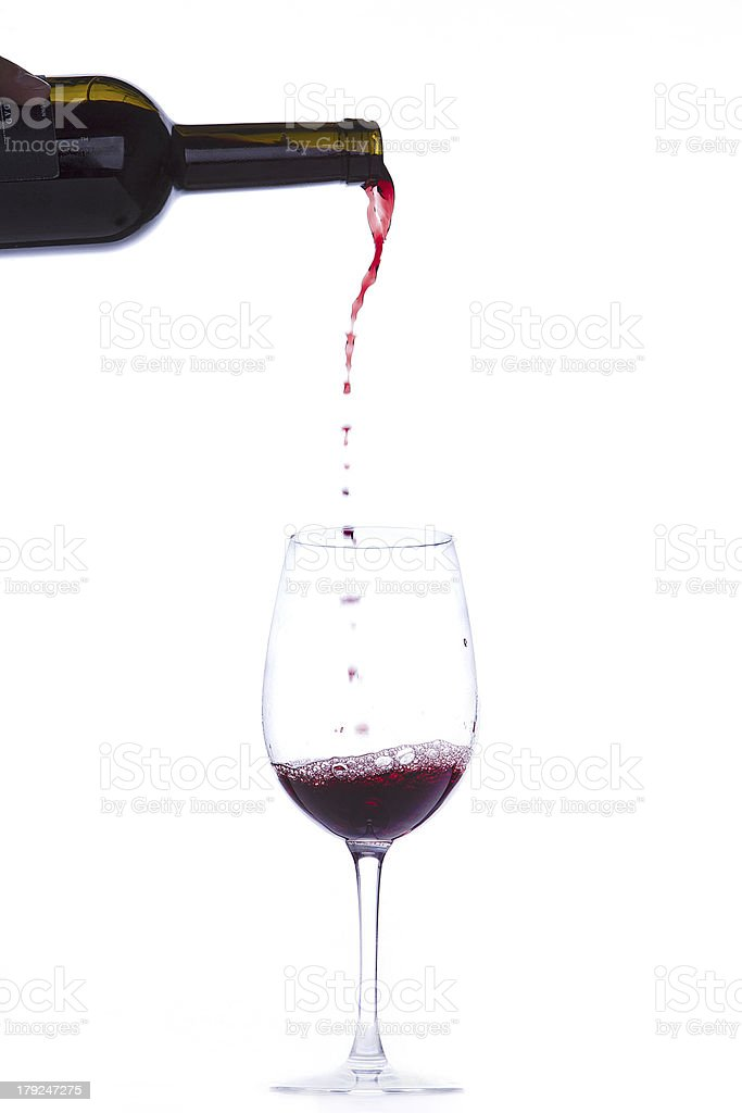 Pouring a glass with red wine royalty-free stock photo