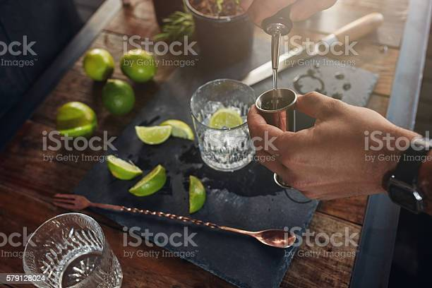 Pouring alcohol in jigger to prepare a cocktail picture id579128024?b=1&k=6&m=579128024&s=612x612&h=iynbakt4ivnpigs5u9pf2hw3acynluupzwiwjn6yeew=