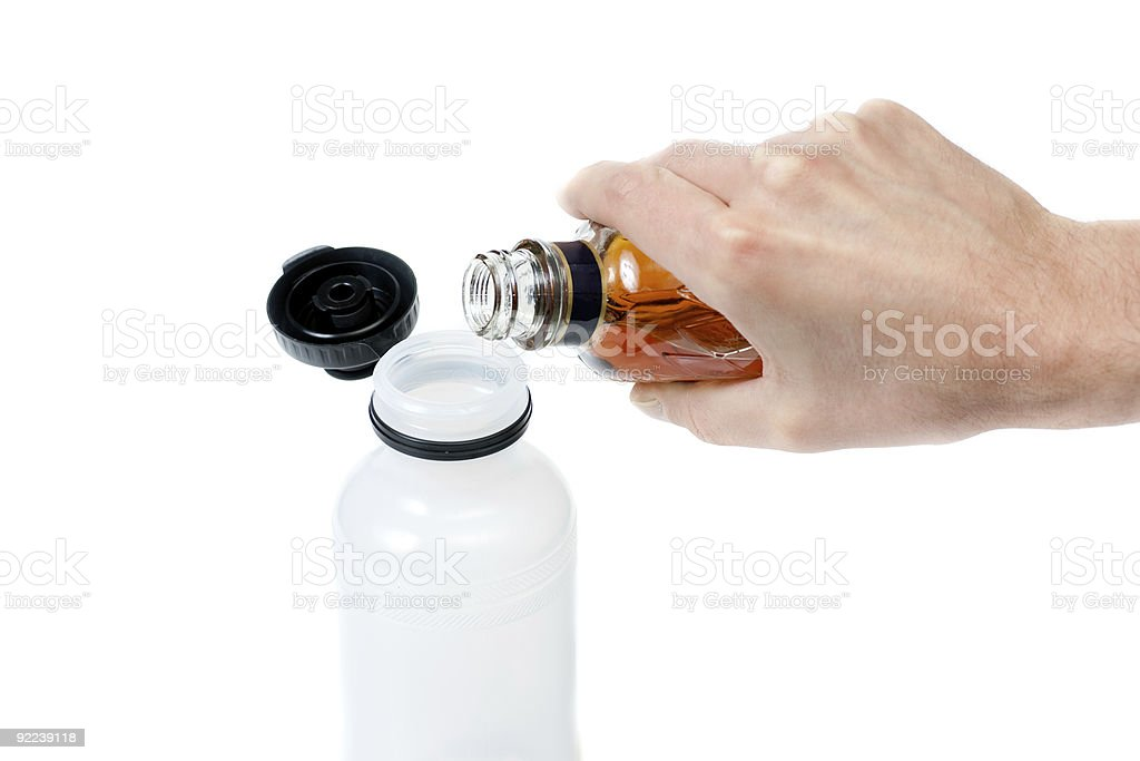 Pouring alcohol in water bottle royalty-free stock photo