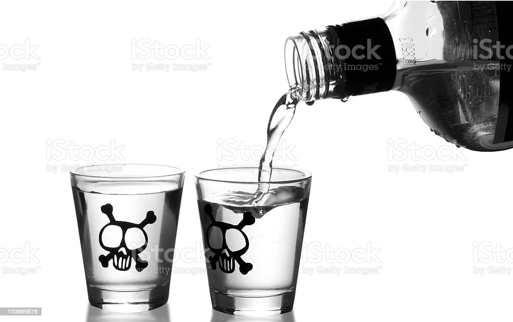 Pouring alcohol into two shot glasses royalty-free stock photo