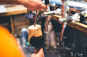 istock Pouring ale from a beer tap 1135285052