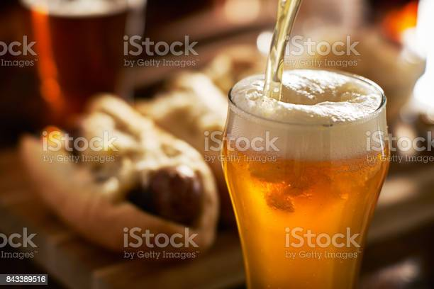Pouring amber beer into mug with bratwursts in background picture id843389516?b=1&k=6&m=843389516&s=612x612&h= glrqqahybcwvuovb5c0hk nmqqg4i5ckn9pzkqjhvy=