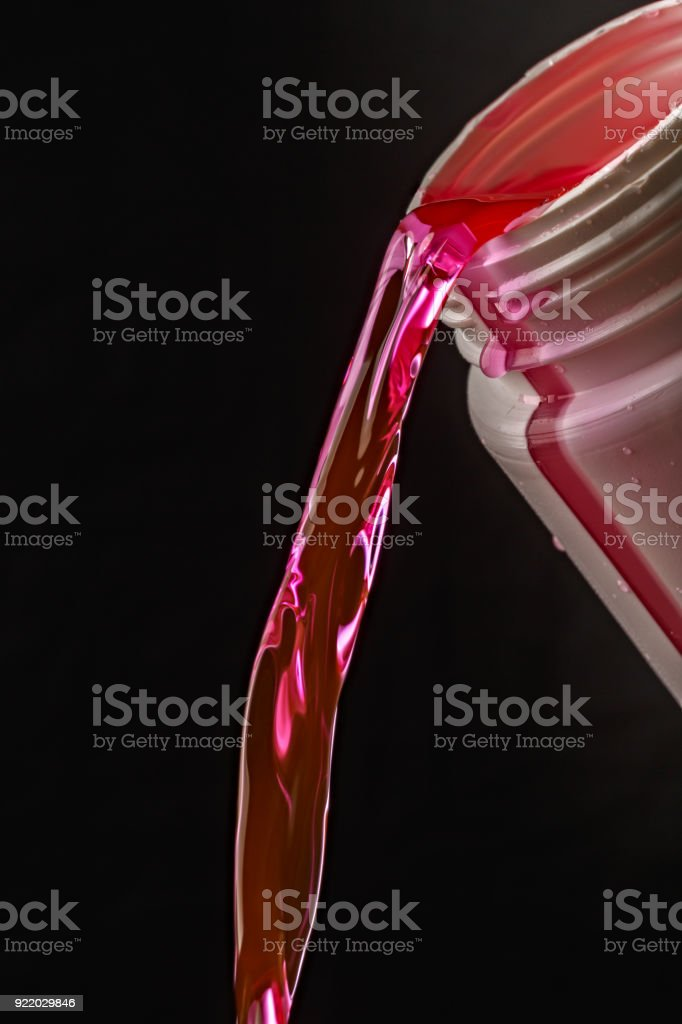 Pouring antifreeze in the engine cooling system of the car. stock photo