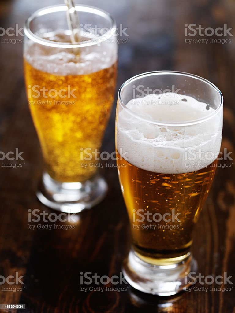pouring beer in background stock photo