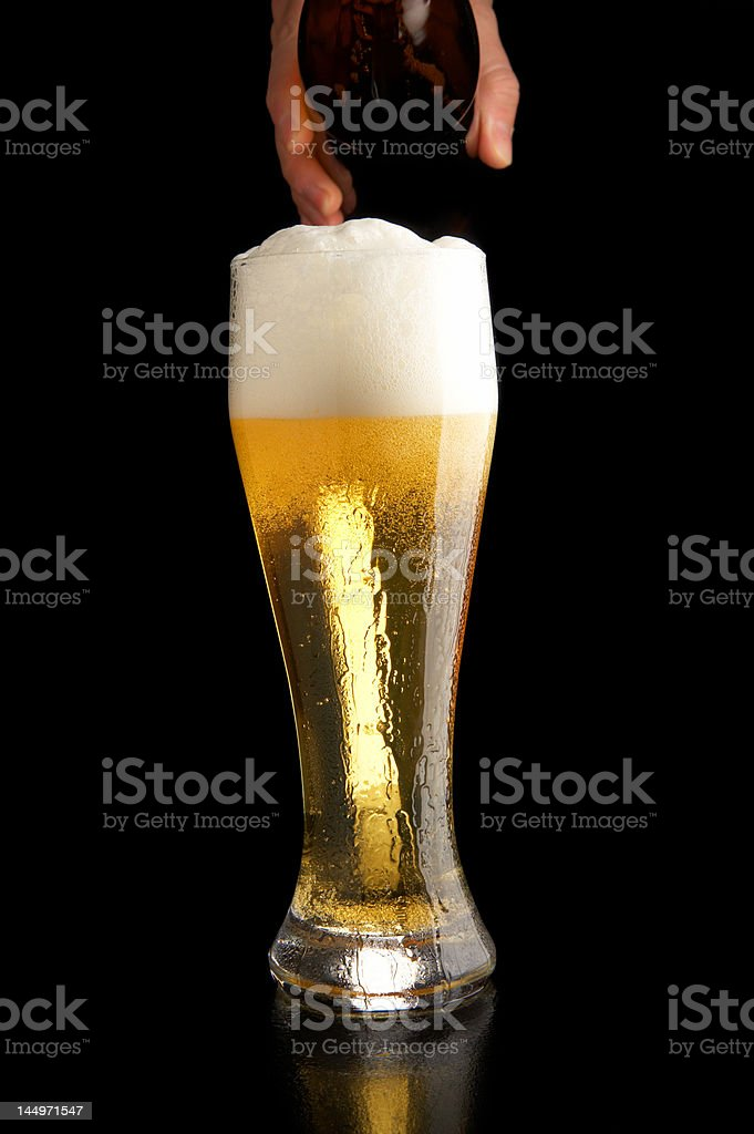 pouring beer into glass royalty-free stock photo