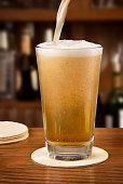 Filling a pint of cold beer at a bar.
