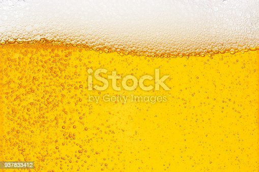 Pouring beer with bubble froth in glass for background on front view wave curve shape