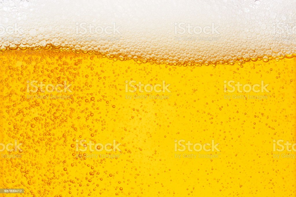 Pouring beer with bubble froth in glass for background on front view wave curve shape stock photo