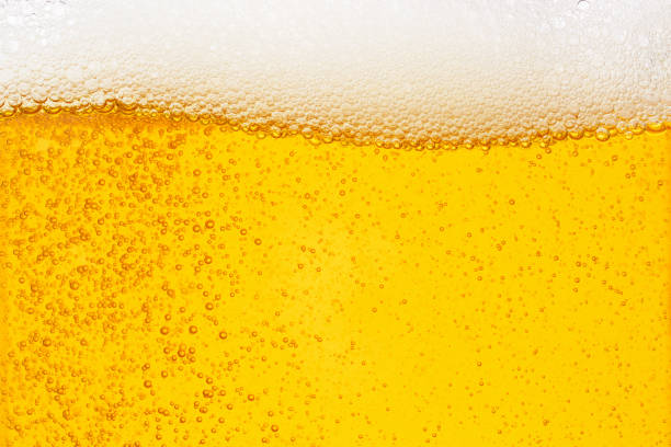 pouring beer with bubble froth in glass for background on front view wave curve shape - beer alcohol stock pictures, royalty-free photos & images