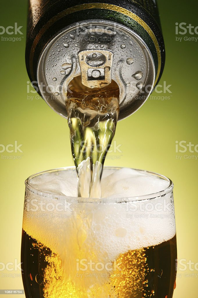 pouring beer with drink can stock photo