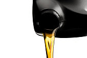 istock Pouring car oil  from bottle isolated on white background 1090694178