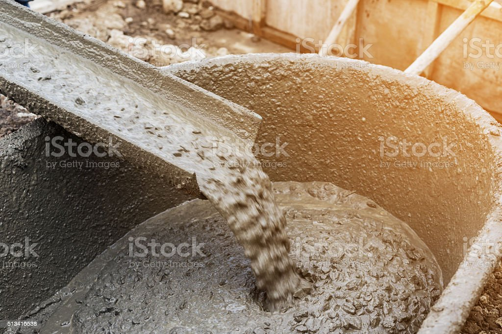 Pouring cement during for construction with with vintage tone. stock photo