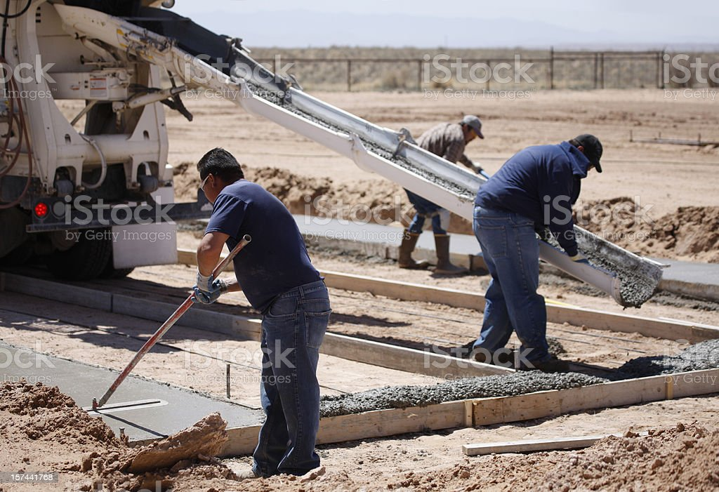 Pouring Cement for a Home Foundation royalty-free stock photo