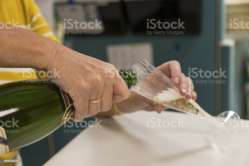 pouring champagne into glass stock photo