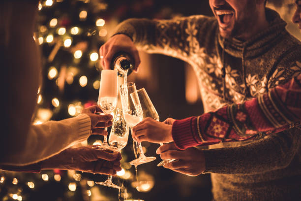 Pouring champagne on New Year's party! stock photo