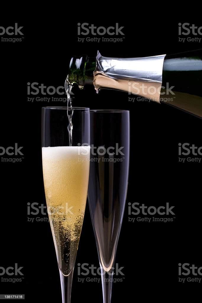 Pouring Champagne royalty-free stock photo