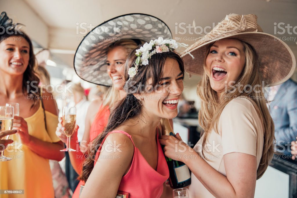 Pouring Champagne with Friends stock photo