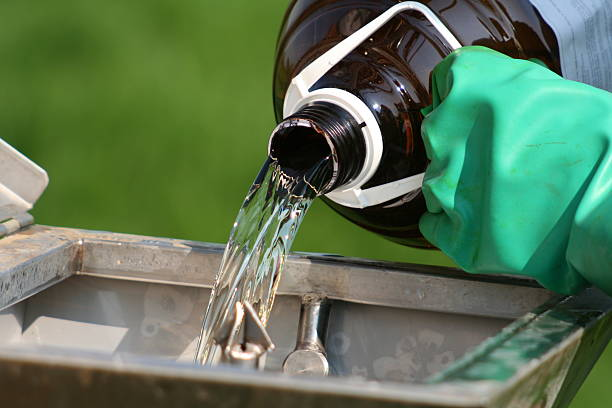 pouring chemical - sports glove stock photos and pictures