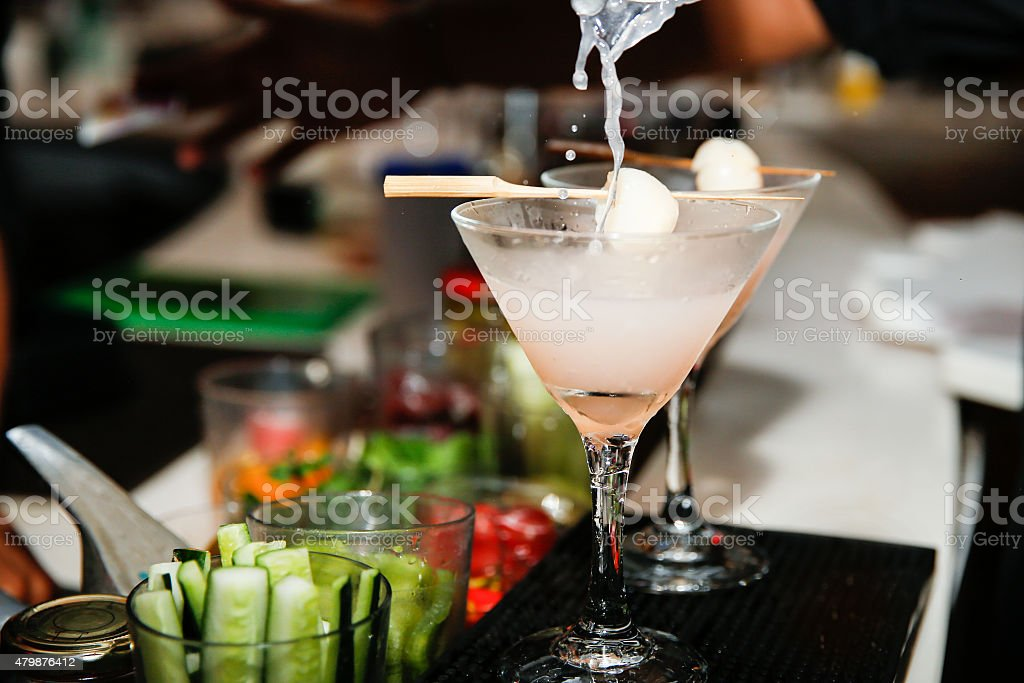 Pouring cocktails lychee martini stock photo