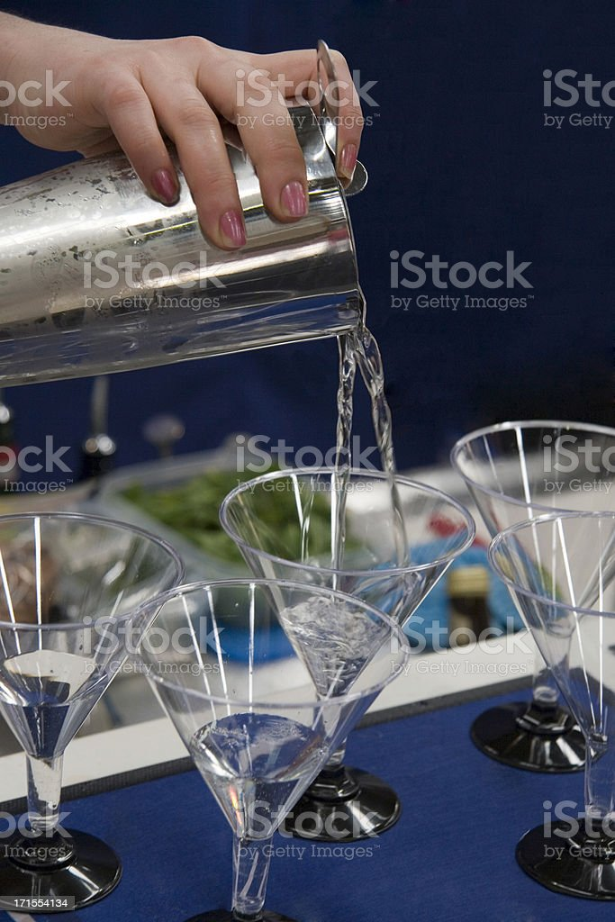 Pouring cocktails stock photo