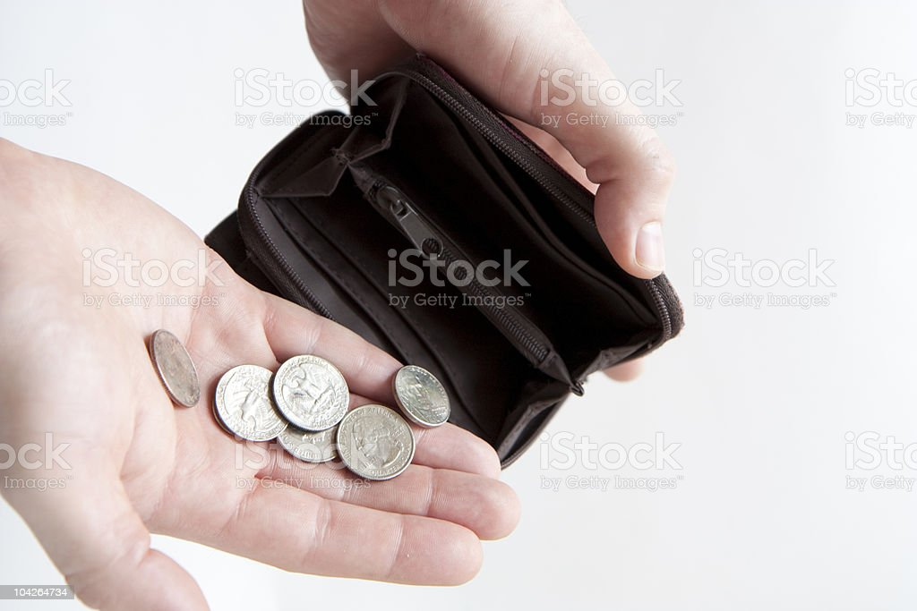 Pouring coins into empty wallet stock photo