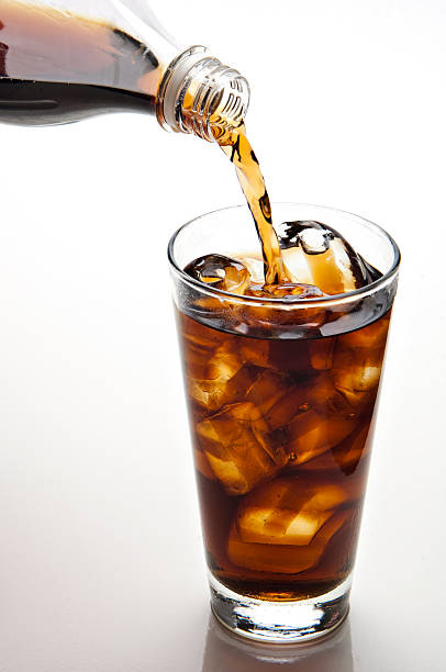 pouring cola stock photo