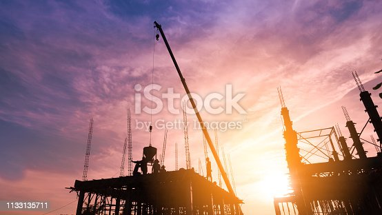 pouring concrete on high ground over blurred background sunset pastel