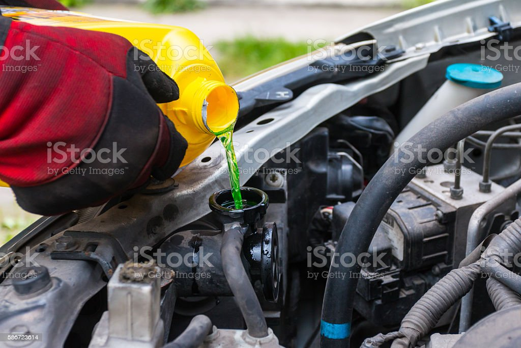 Pouring coolant stock photo