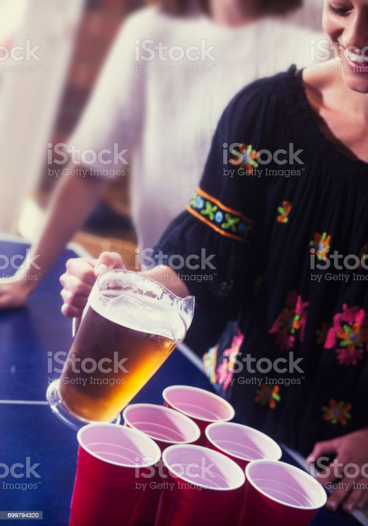 Pouring drinking at a party stock photo