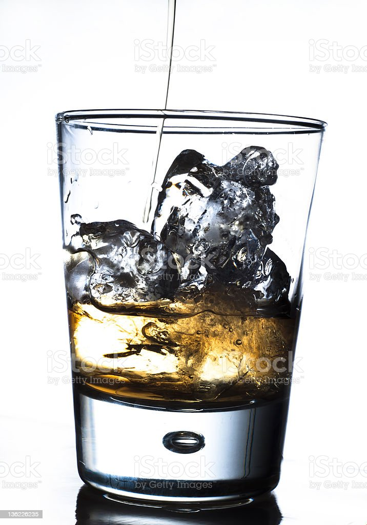Pouring drinks in a glass royalty-free stock photo