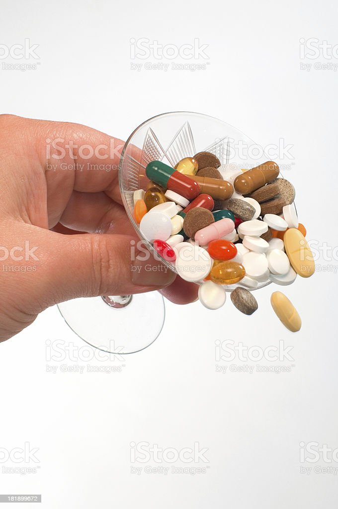 pouring drugs stock photo