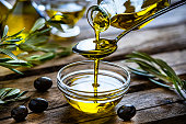 istock Pouring extra virgin olive oil in a glass bowl 1206682746