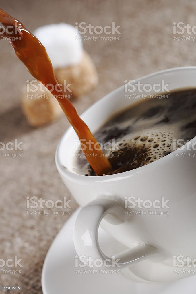Pouring  Fresh  Brewed Coffee in white cup royalty-free stock photo