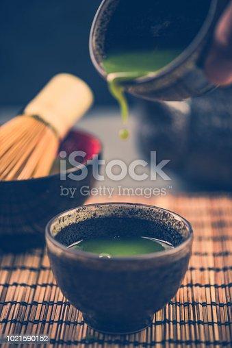 istock Pouring green tea, drinking tea ceremony 1021590152