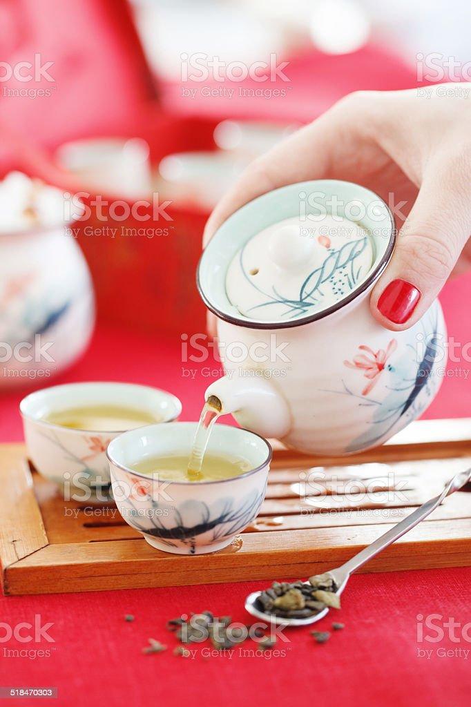 Pouring green tea stock photo